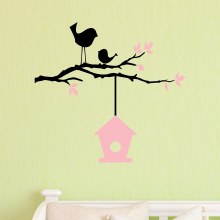 Birds on branch with birdhouse