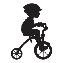 Silhouette of a boy riding a tricylce