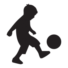 Silhouette of boy kicking ball